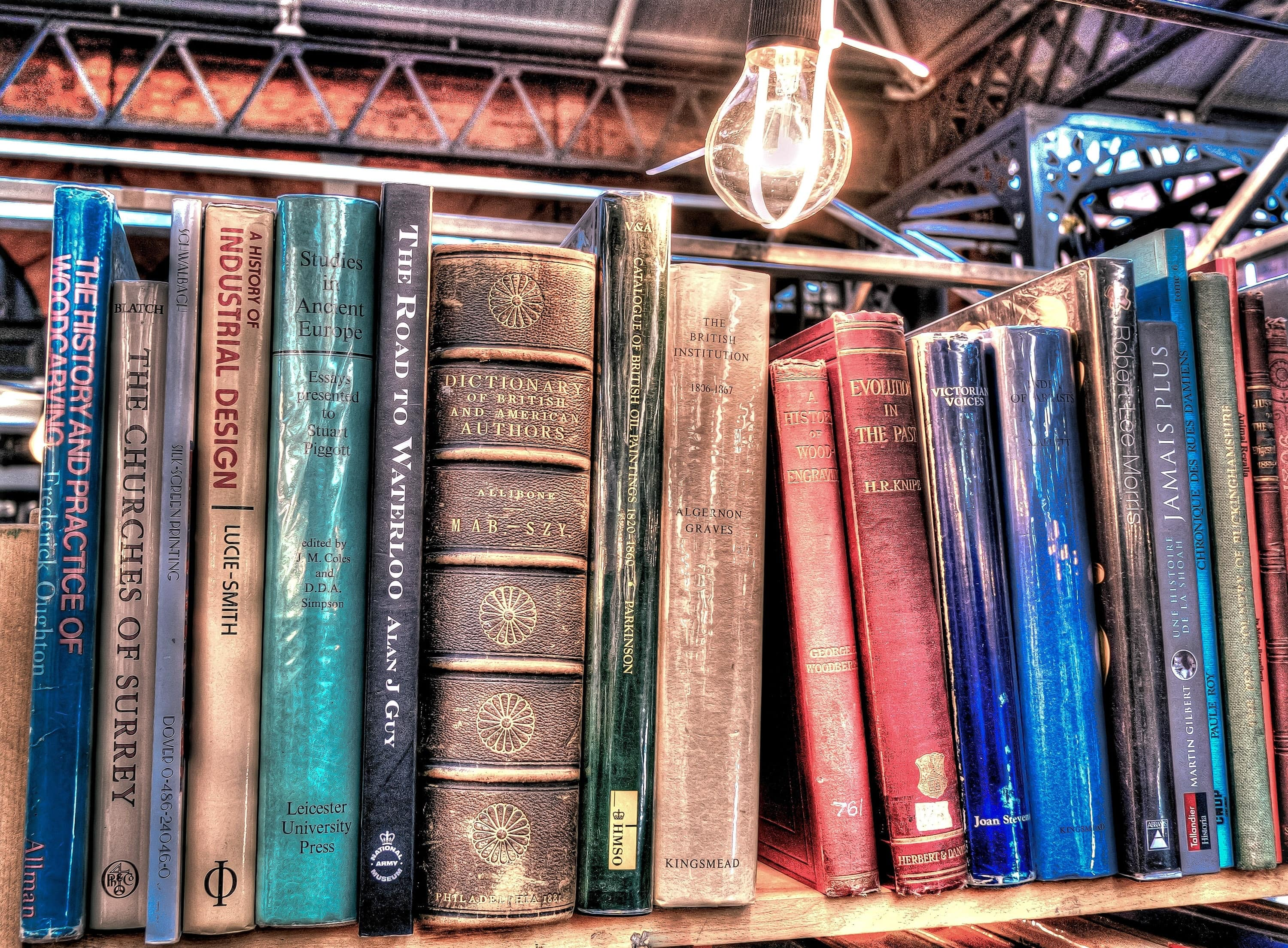 aged-antique-book-stack-459694