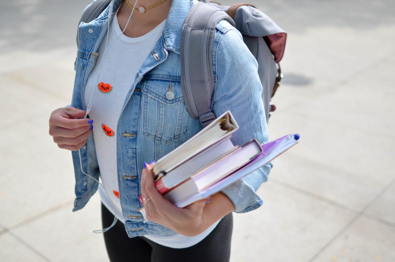 girl holding books